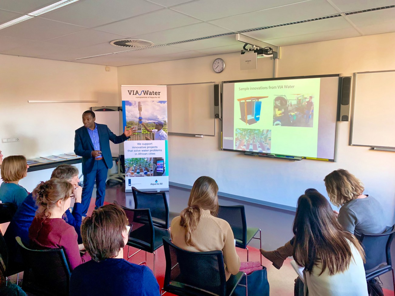 Silas presenting at Station 1 at the Workshop on Water Innovation in Africa at IHE Delft